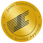 The gold, circular Joint Commission seal.